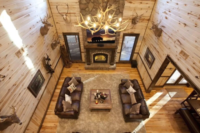 interior sitting room with fireplace in luxury cabin in broken bow