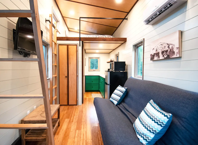 Tiny home interior with loft bed