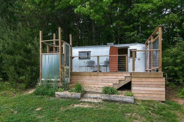 Vintage glamping camper on organic farm exterior