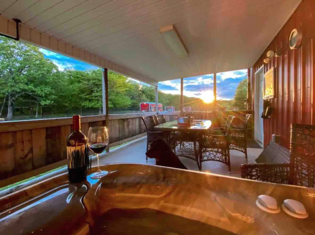 Cabin porch with hot tub