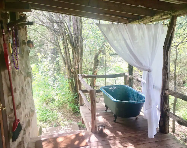 outdoor tub on cabin porch