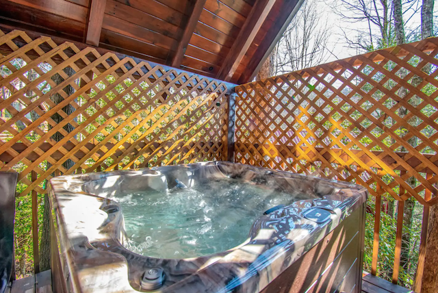 Patio hot tub of an Airbnb cabin rental
