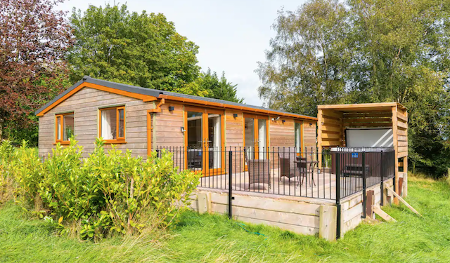 Isabella Lodge Cabin in Lancashire with hot tub on patio