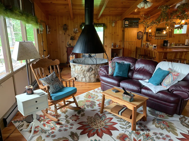 Seldom Inn Guest House living room with sofa, rocking chair and fireplace