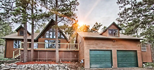 Squirrel Hill Cabin With Hot Tub exterior around sun set