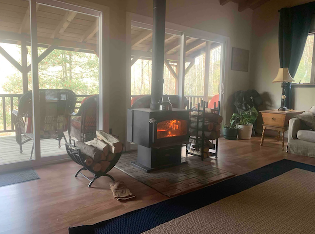 Mountain Rock Cabin interior with fireplace and view